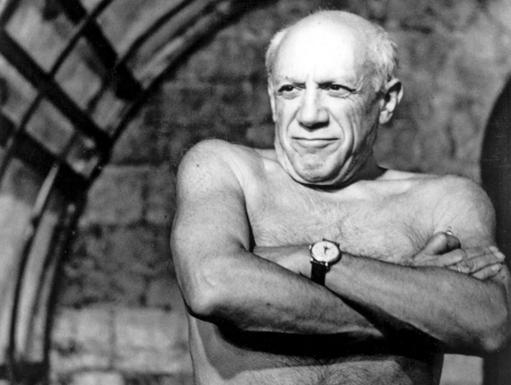 Pablo Picasso wearing a Patek and no shirt.