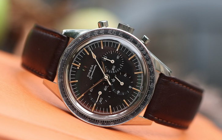 Omega Speedmaster with faded bezel and beautiful patina on the markers and hands.