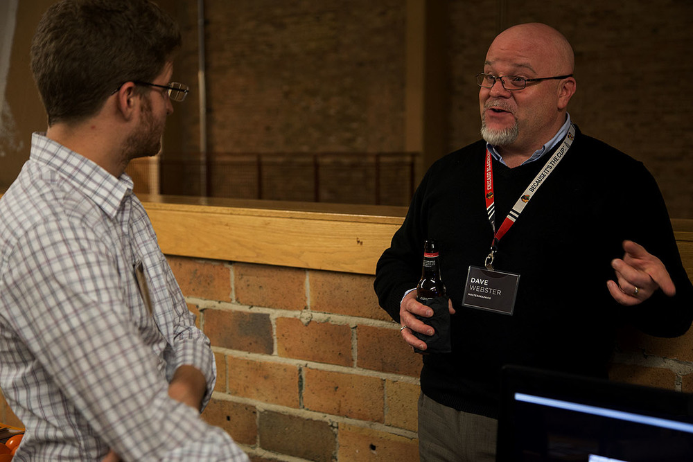 David Webster (right) of  MasterGraphics  discusses 3D printing with event attendee,Daniel Konow