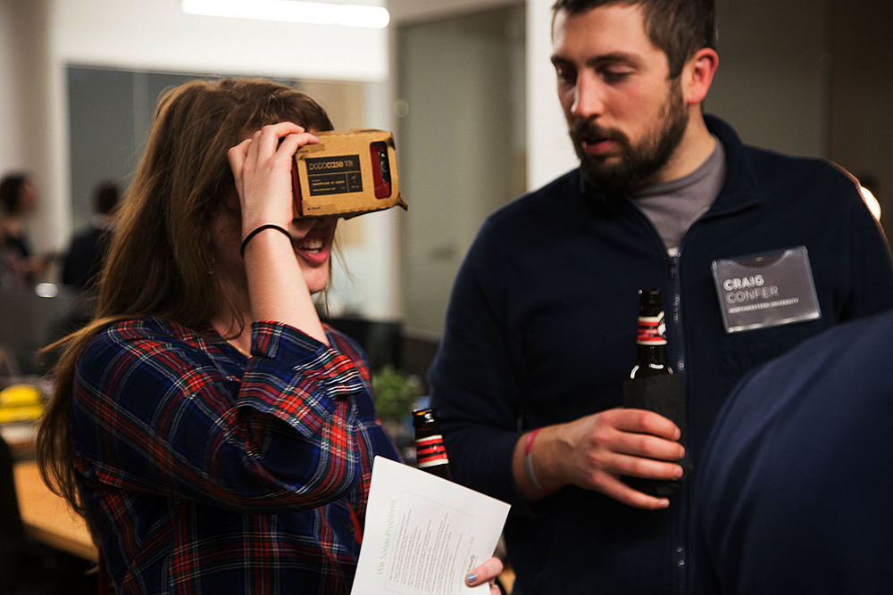 Jennifer Forestal and Craig Confer, students of Northwestern University , test out Google Cardboard with their phones.
