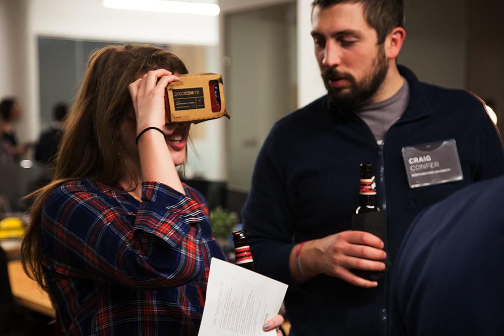Jennifer Forestal and Craig Confer, students of  Northwestern University , testout Google Cardboard with their phones.