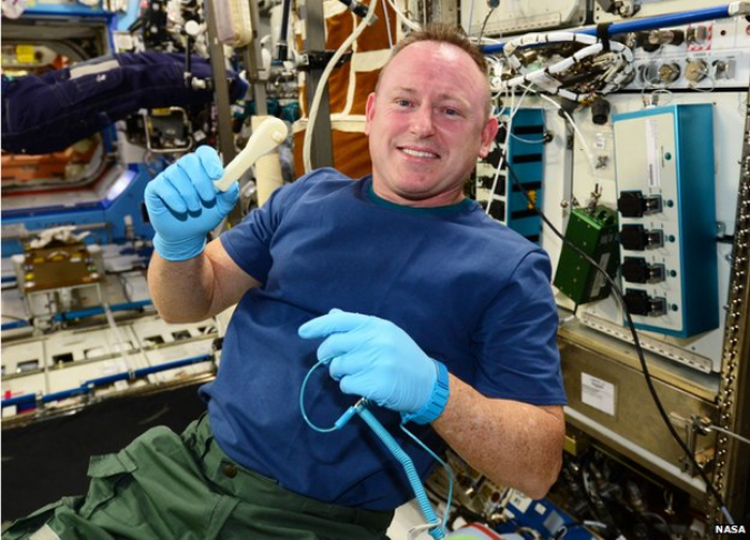 ISS Commander Butch Wilmore holds up the ratchet after removing it from the print tray. (NASA Photo)