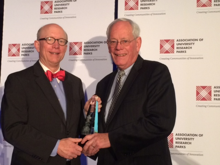 "In November, the Association of University Research Parks named IIT's University Technology Park as ""the #1 emerging tech park in the world."" Above, the author (right) accepts the award from AURP VP Greg Hyer of the UW-Madison."
