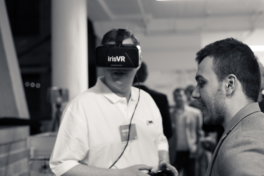 Dan Bulley of the Mechanical Contractors Association of Chicago tries out a headset with IrisVR's 3D guru Amr Thameen.