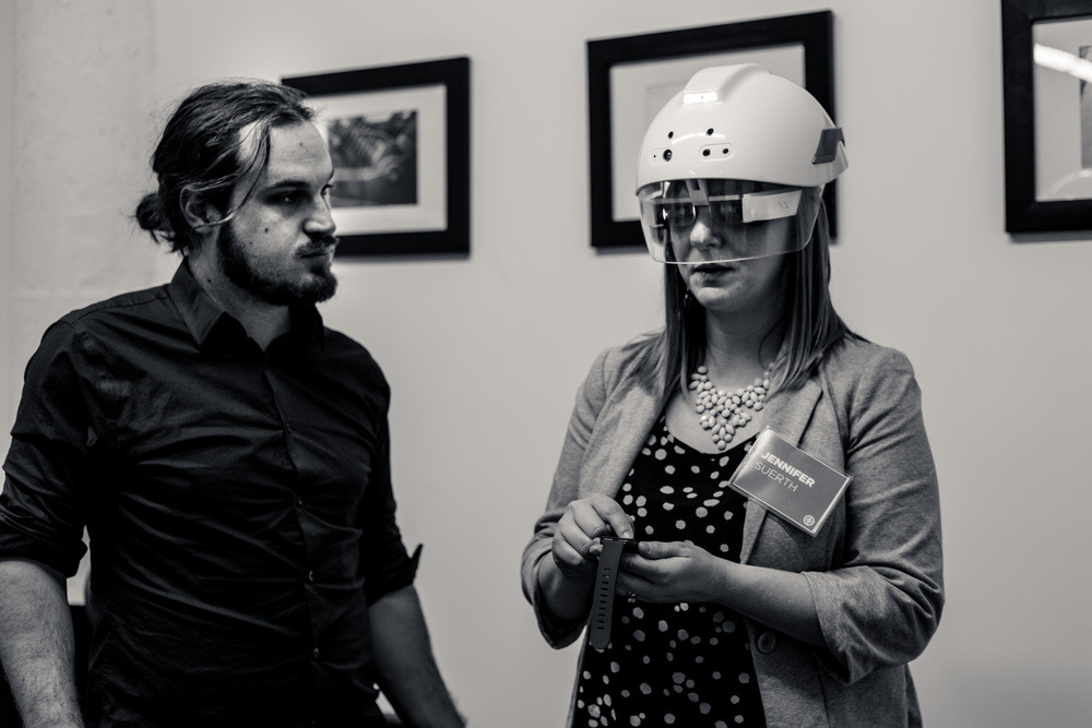 Jennifer Suerth (right), one of Mortenson's leading virtual managers in Chicago, tries out the DAQRI Smart Helmet.