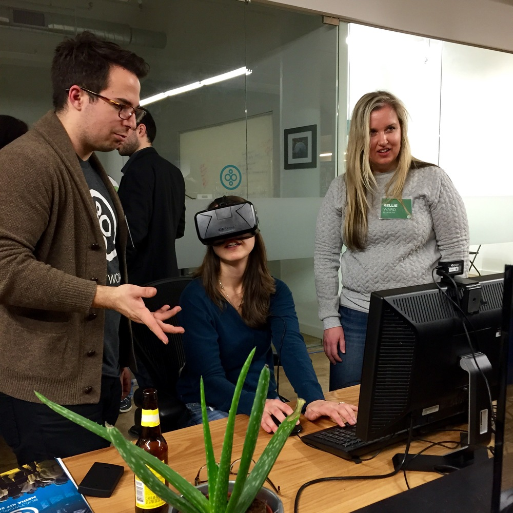 Our own Ian Manger lets the crew from Bluebeam try out one of our VR headsets. (Look up!)