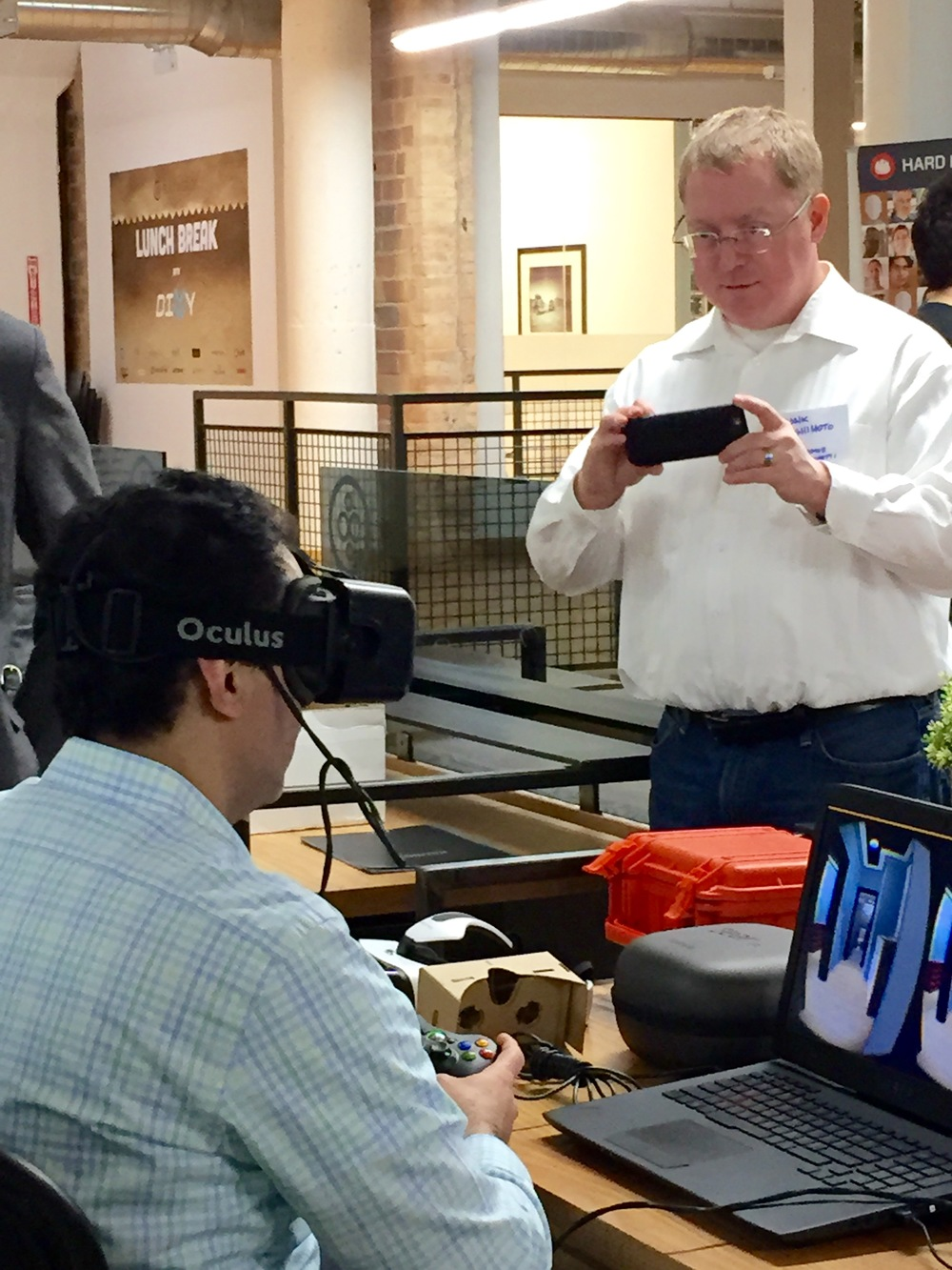A photo of Thornton-Tomasetti's Frank Hashimoto taking a photo of a colleague in virtual reality inside actual reality. Mind blown?