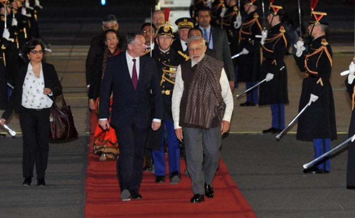 Prime Minister Narendra Modi being greeted by French Sports minister Thierry Braillard upon his arrival at the Paris Orly International airport in France on Friday, April 10. (Photo c/o Press Trust of India)