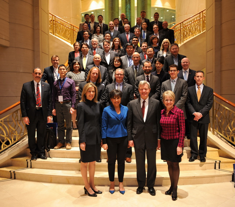 Making history: From left, in foreground, the China Trade Mission was led by Deputy Energy Sec. Sherwood-Randall, Commerce Sec. Pritzker, U.S. Ambassador Baucus, and his spouse, Melody Hanes. The author is near the back of the group, at the top of the stairs, on the right.  (Photo: U.S. Commerce Dept.)