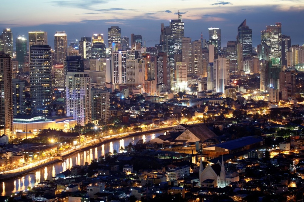 Manila at Night: Energy is pulsing through the Philippine capital, but growth is outpacing existing infrastructure.