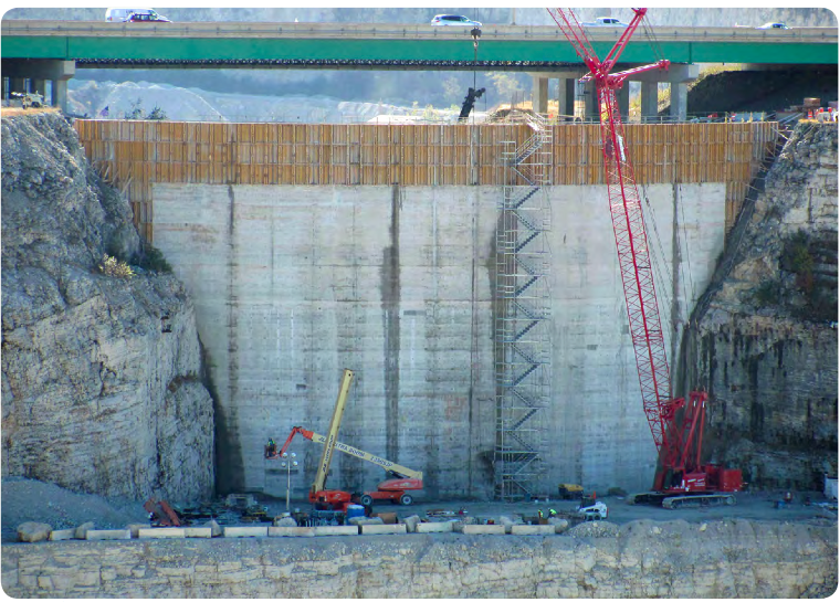 Gap seal: Using 30,000 cu yds of RCC, crews sealed the quarry pass in 2012with a 'gap' dam, 115-ft tall by240-ft wide.
