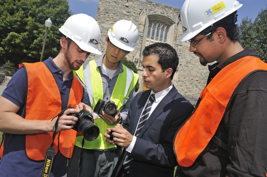 Tech tips: University of Illinois Engineering Prof. Golparvar-Fard instructs student researchers on jobsite camera use.