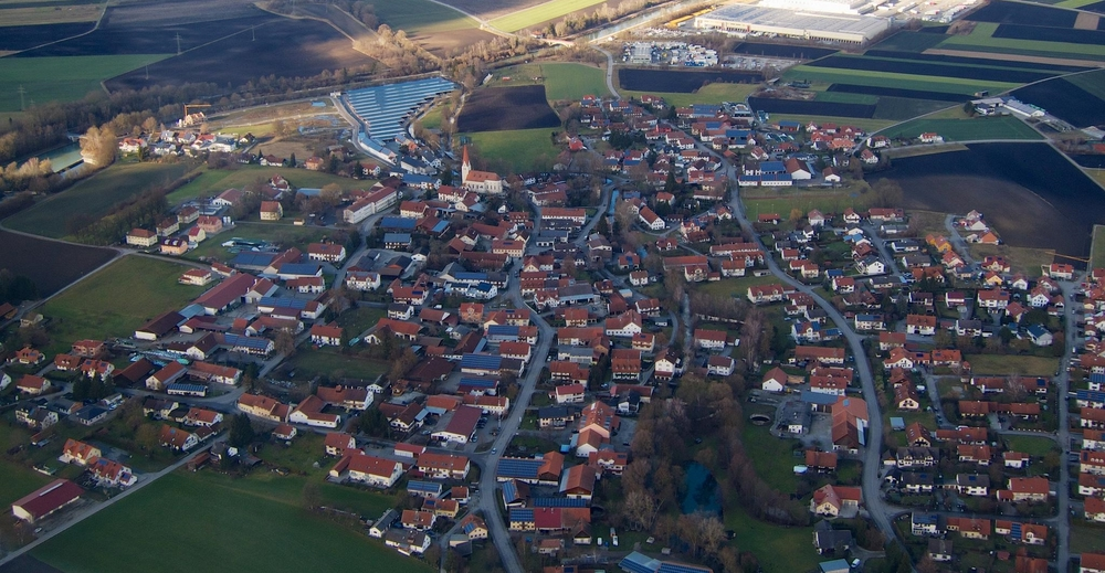 Not swimming pools. Those are solar panels on the roofs of houses in the village of Eitting near Munich, Germany.