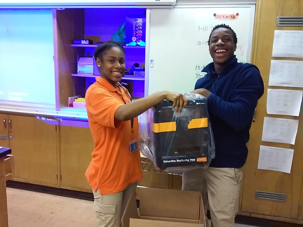 CLICK < > Students joyously unboxed the new Makerbot in December.          (All photos by the author.)