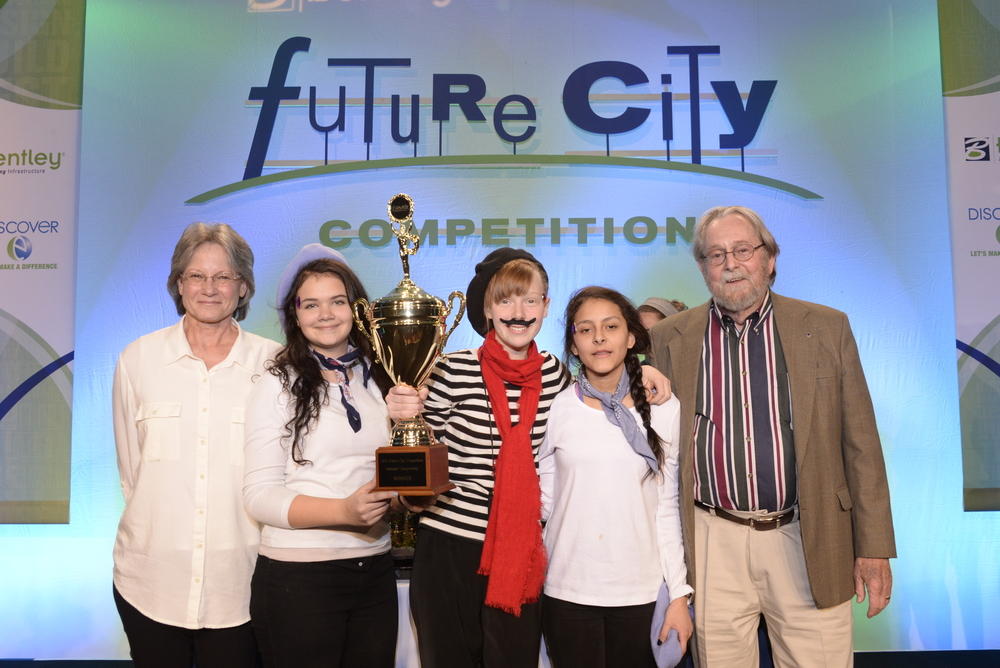Future Waste: The Grand Prize winner of the 2016 Future City® Competition was engineered by students from the Academy for Science and Foreign Language in Huntsville AL. From left, teacher Angela Traylor, Isabel Waring,12, Hannah White,14, Alexa Huerta,13, and volunteer mentor Raymond Woodson, a retired aeronautical engineer.