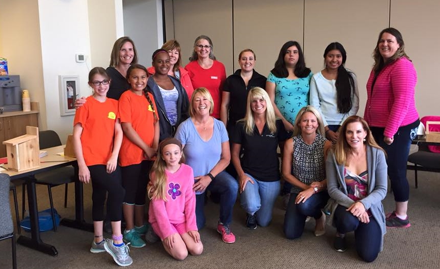 NAWIC Puget Sound: Above, the author (kneeling, blue shirt) joins colleagues in mentoring young female students.