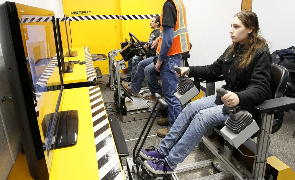 Female student at Hawkeye Community College in Waterloo IA, operates an excavator simulator. (Photo: Brandon Pollock)