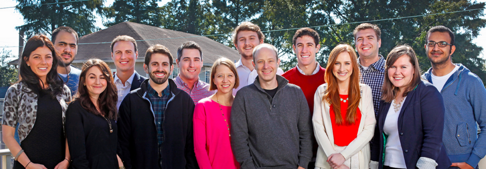 Bigger, easier: Founder Scott Wolfe (center, gray pullover) leads one happy, growing staff in the Crescent City.