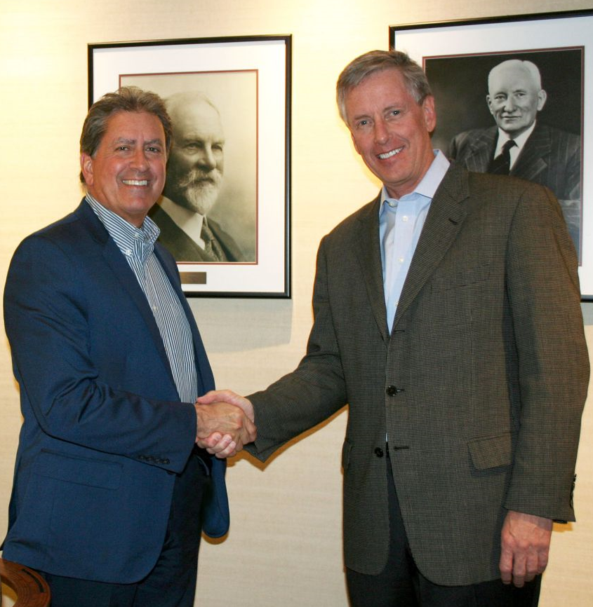 Shake on it: Stantec's Gomes (l) and MWH's Krause.