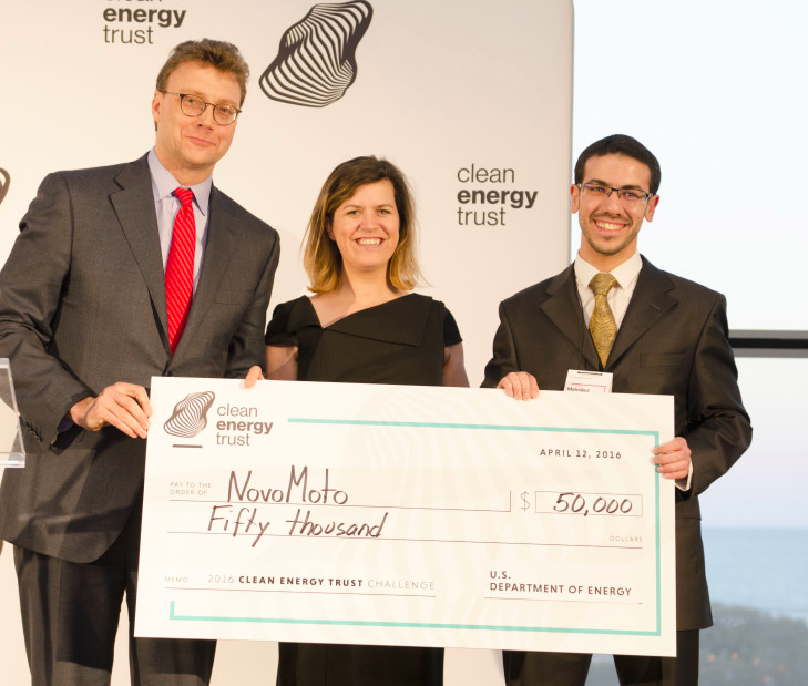 Financial aid:On behalf of NovoMoto,UW-Madison's Mehrdad Arjmand (right) collects the U.S. Dept. Energy's Cleantech University Prize. CET CEO Eric Birkerts and USDOE's Jennifer Garson make the presentation.