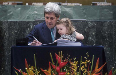 Generations: U.S. Secretary of State John Kerry held his grandchild while signing the historic accord.