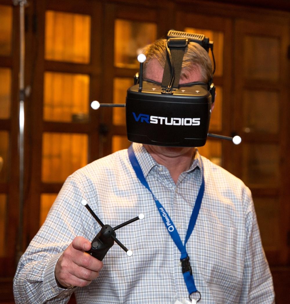 MCAA Tech Chair Brian Helm, president of Mechanical Inc., tries on the VRstudios headset.