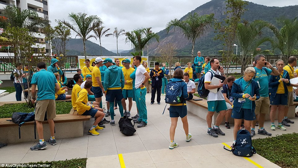 They're outa here! Unhappy Australian athletes were evacuated from their unfinished quarters (below) and relocated.