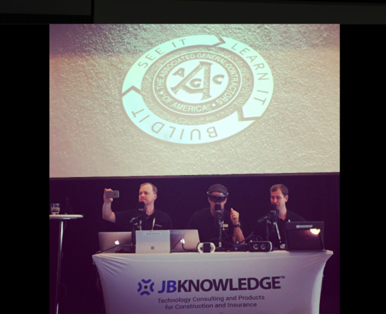"""ConTechTrio """"live-streamed"""" their weekly podcast from the AGC-IT Forum stage on the morning of Day 2. From left, they are Rob McKinney (@ConAppGuru), James Benham (@JBKnowledge), and Josh Bone (@BIM2theBone)."""