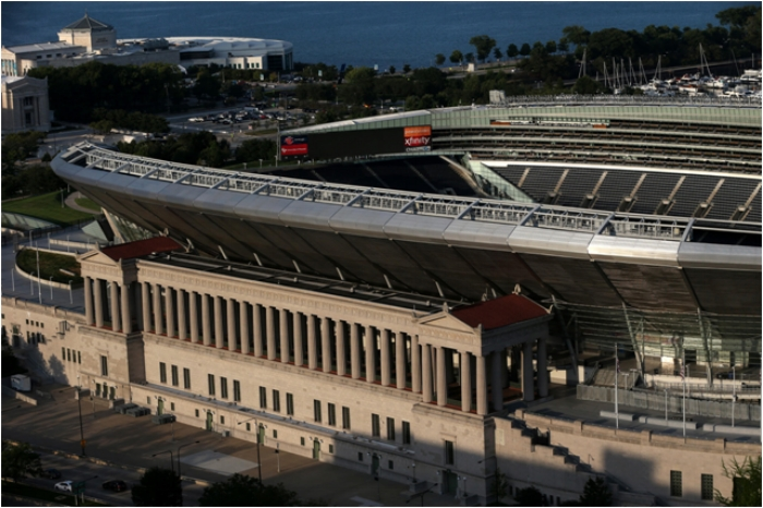 Jarring juxtapositions: In 2003, it appeared a 'flying saucer' had landed on the classical Soldier Field. Below, the adjacent Lucas Museum of Jabba the Hut this year packed up its renderings and returned to Hollywood in the face of public protest.