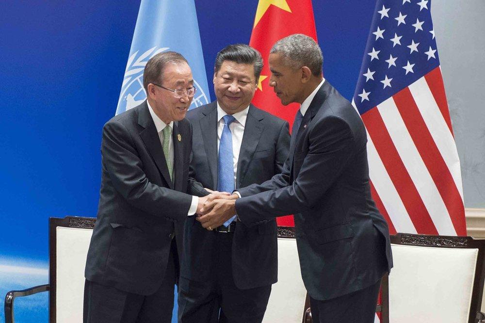 On board: UN Secretary General Ban Ki-moon (left) congratulates Presidents Obama and Xi for making good on Paris.