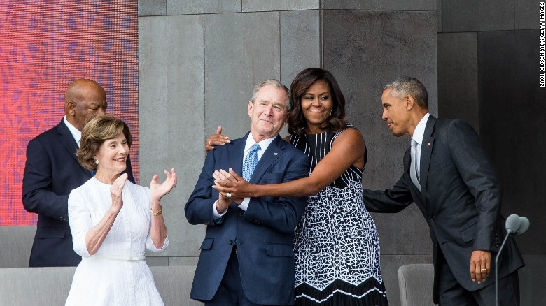 National unity moment: President Obama and First Lady Michelle Obama celebrate the new museum's Sept. 24 opening with ex-POTUS George W. Bush and former FLOTUS Laura Bush, backed by Rep. John Lewis (D-GA). Encased in intricate lattice work, the five-story, glass-walled structure is wrapped in 3,600 porous, bronze-colored, cast-aluminum panels, collectively weighing 230 tons. (Photos: Getty Images and Adjaye and Associates)
