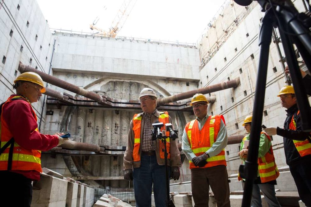 Good news, at last. STP project manager Chris Dixon (center, left) and Alaskan Way Viaduct Replacement Program administrator Joe Hedges (center, right) at the Oct. 3 press conference. (Photo: Grant Hindsley, SEATTLEPI.COM)