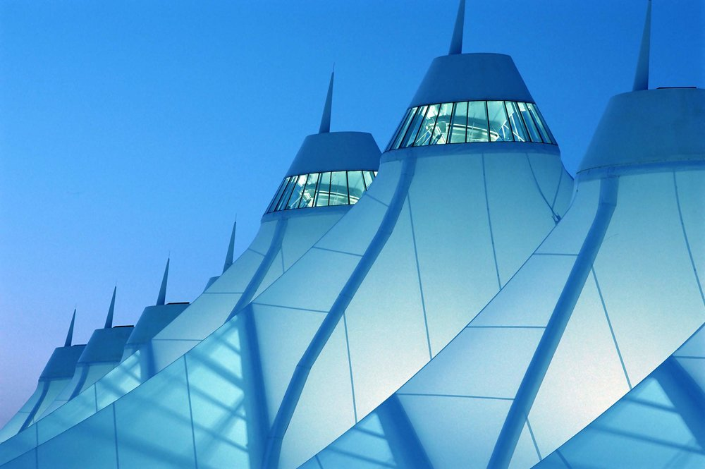 Denver International Airport's iconic white canopies also housed the control towers, adding to the overall complexity.