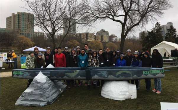 IIT's Concrete Canoe team poses with their finished (and repaired) canoe.