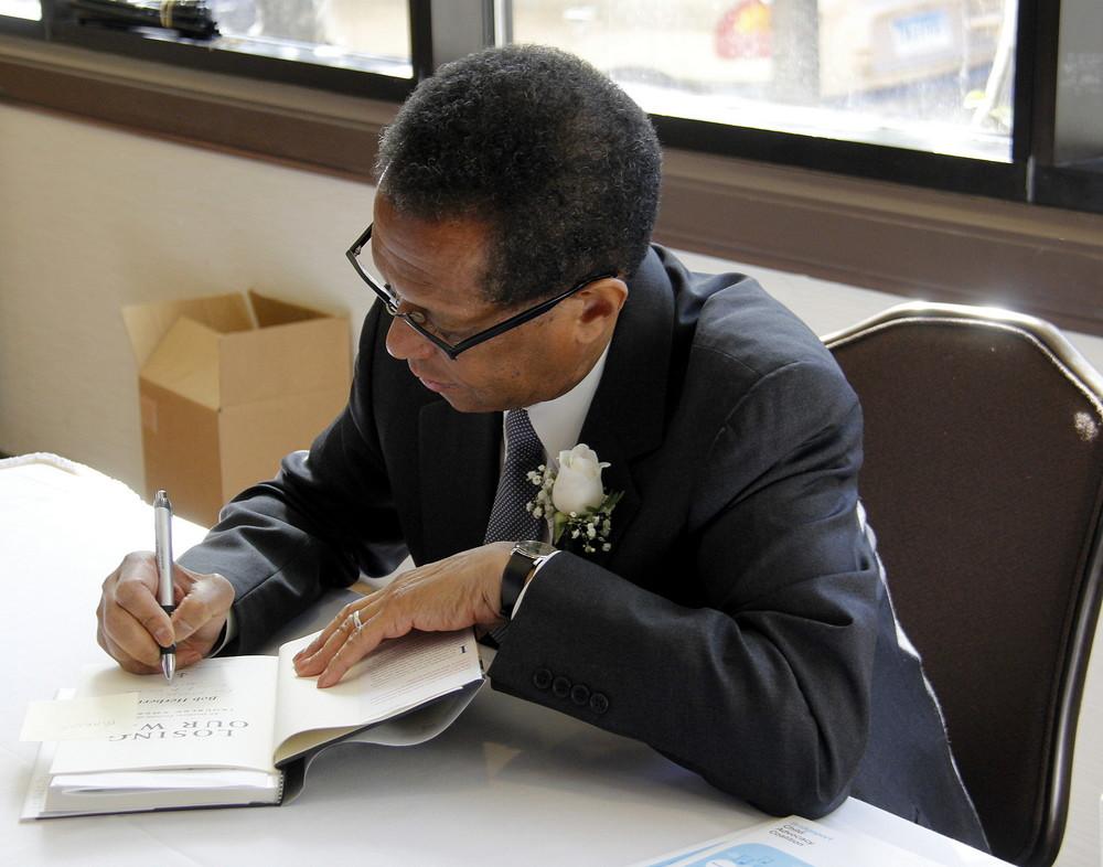 Keynote speaker Bob Herbert signing books