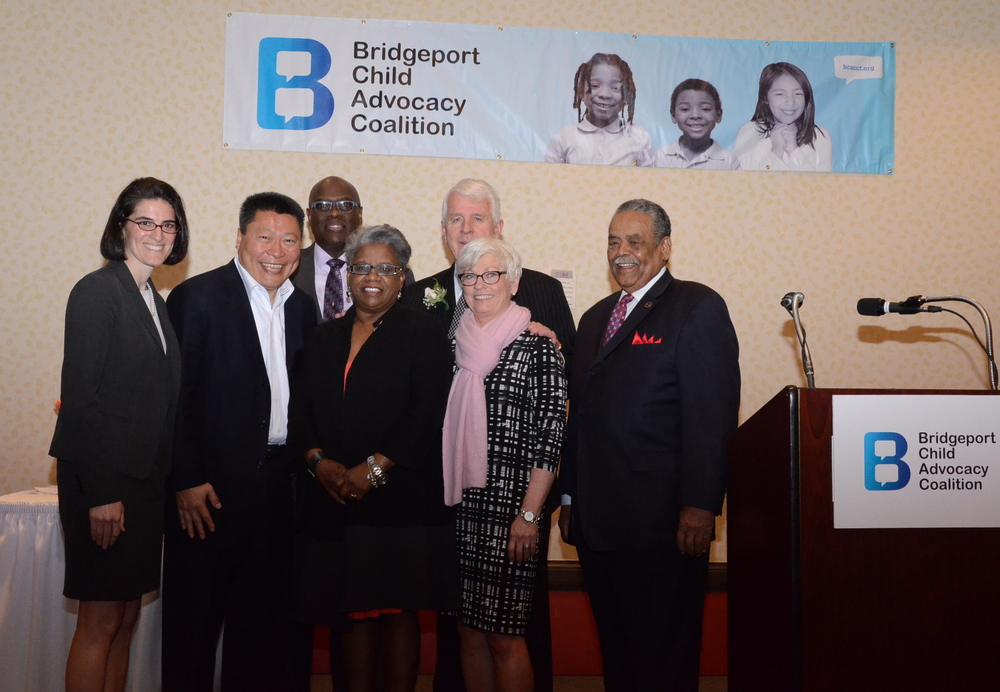 Representative Cristin McCarthy Vahey, Senator Tony Hwang, Representative Charles Stallworth, Senator Marilyn Moore, BCAC Executive Director Mary Pat Healy, Honoree John Santa of Malta Justice Initiative and Senator Edwin Gomes