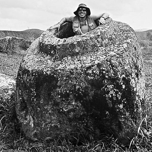 Trevor Weeks thoroughly enjoying The Plain of Jars, Laos.