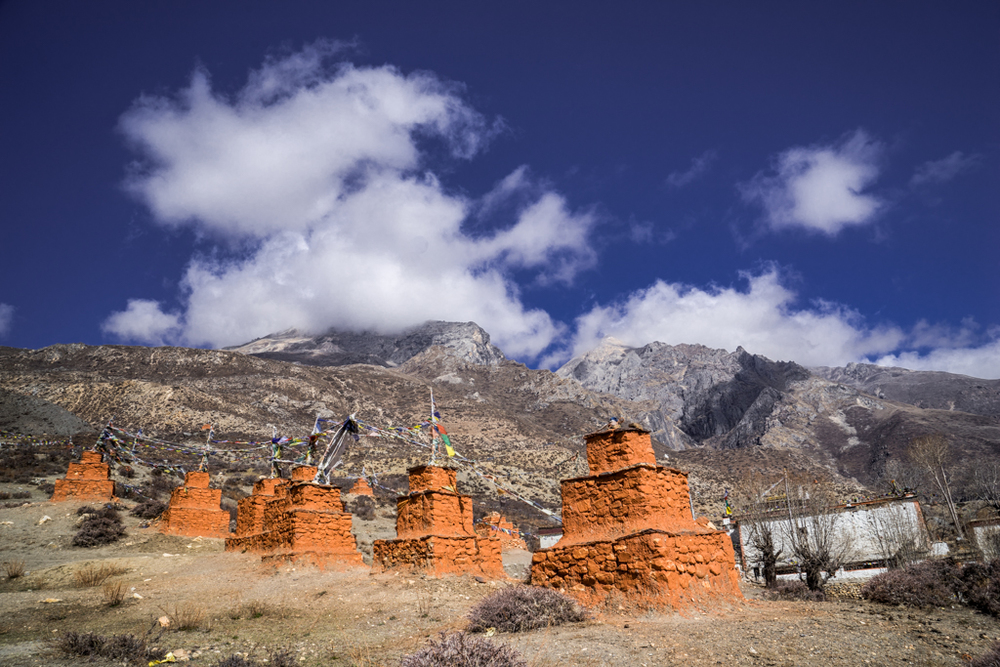 Red chorten before monastery