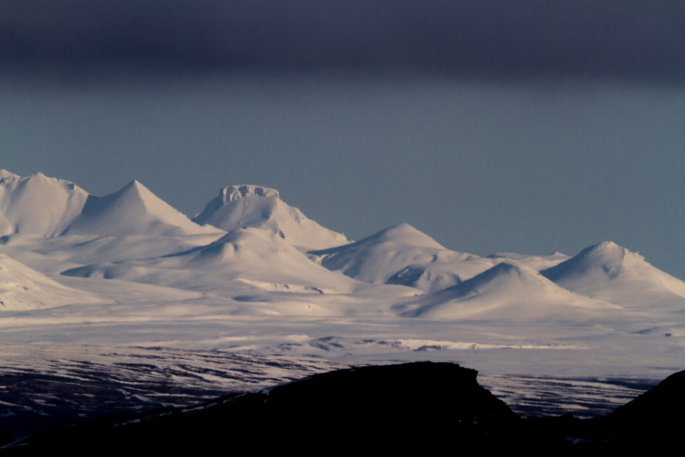 Conic mountains in the distance