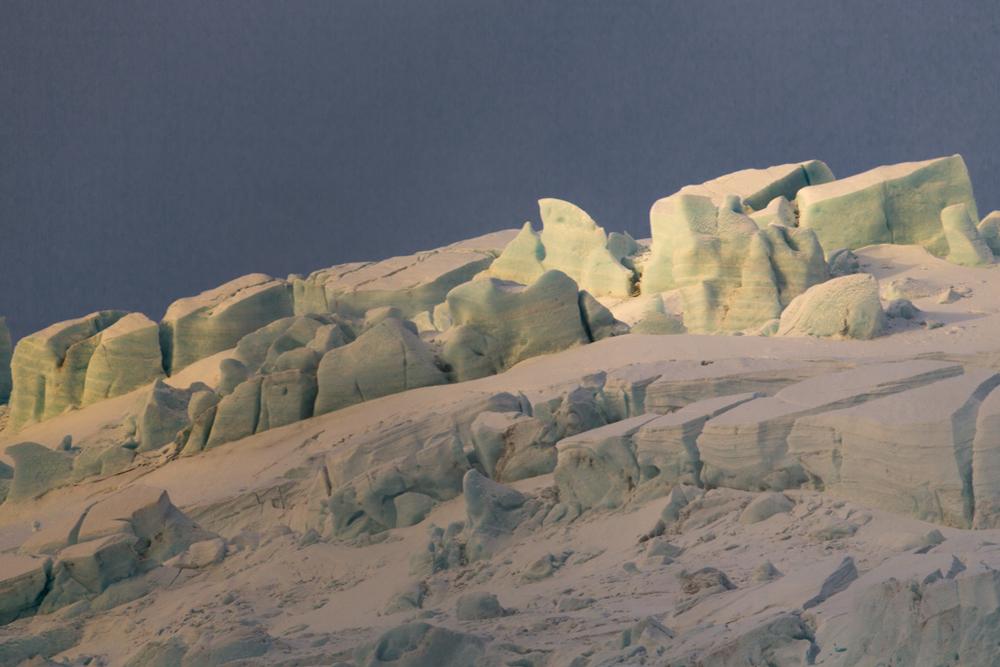 Late sun on a crevassed glacier
