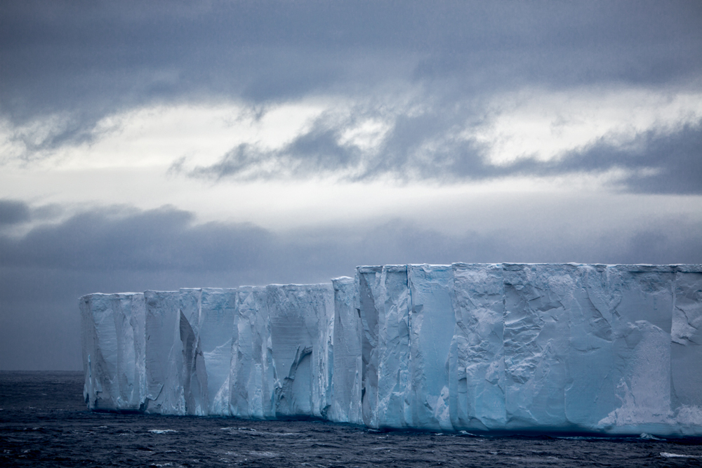 Blue iceberg with dark clouds