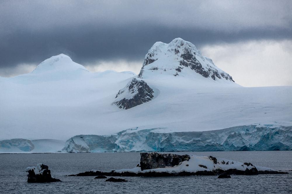 Glacier with dark clouds