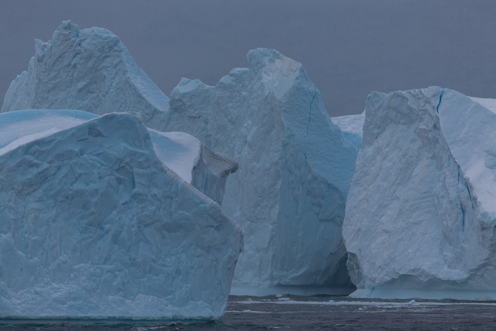 Huge, blue-colored icebergs