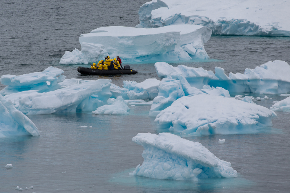 Zodiac boat among ice floes