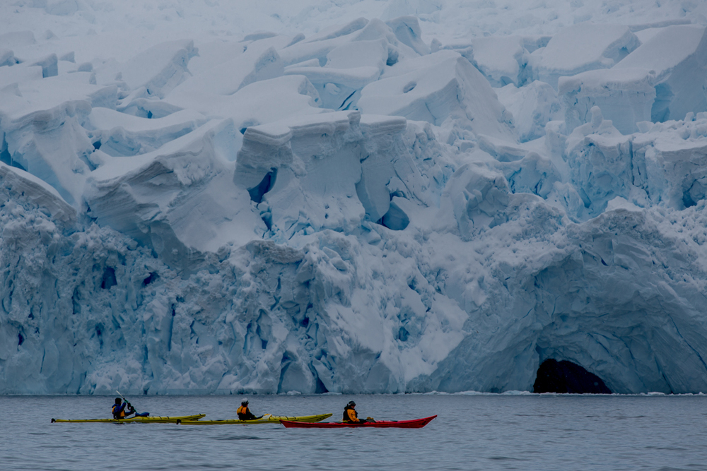 Kayaking below an icefall
