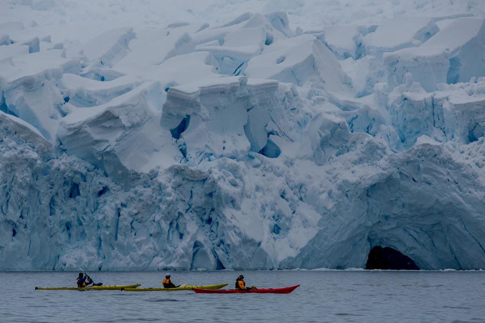 Kayaking below an icefall