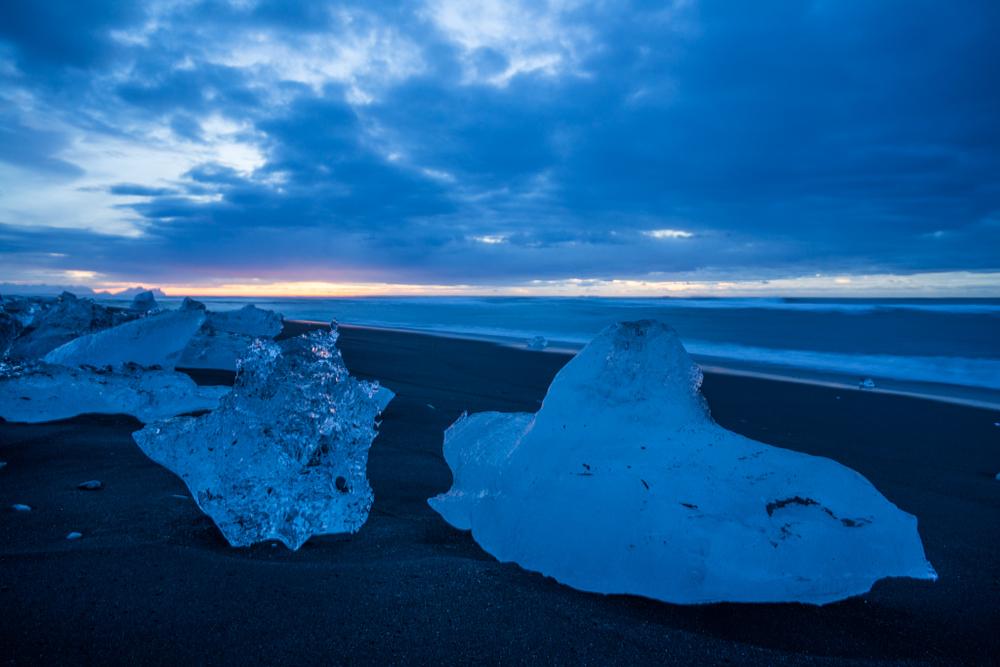 Blue ice lying on the beach