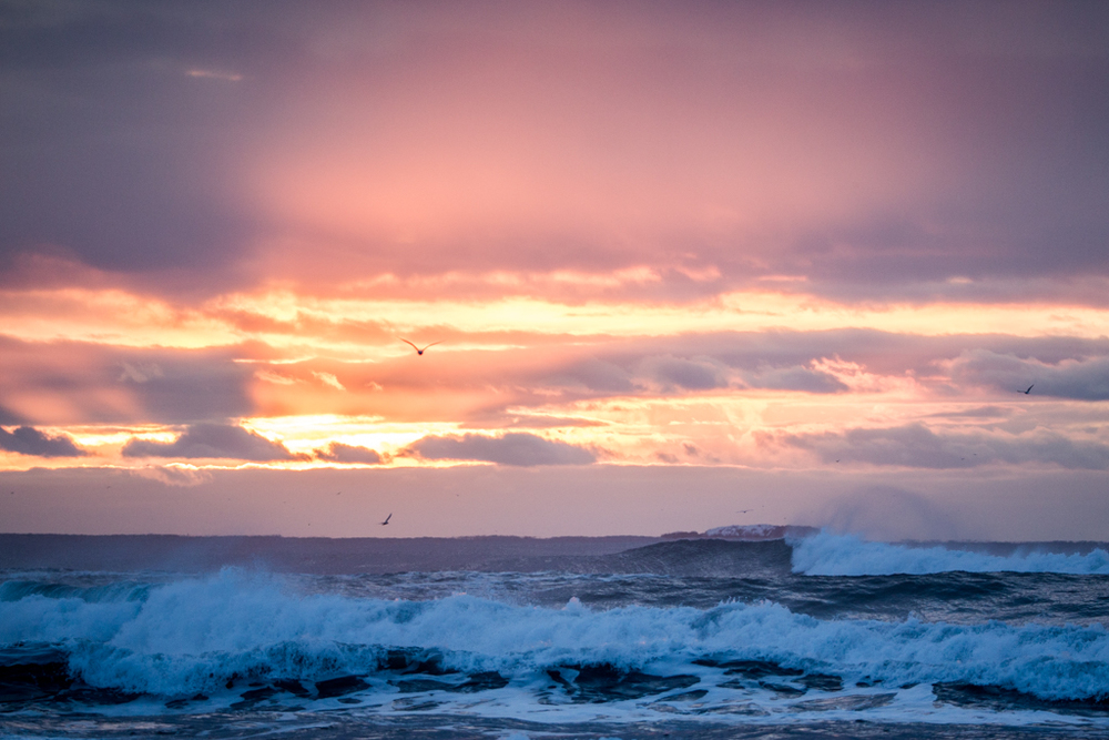 Sunrise and waves in South Iceland