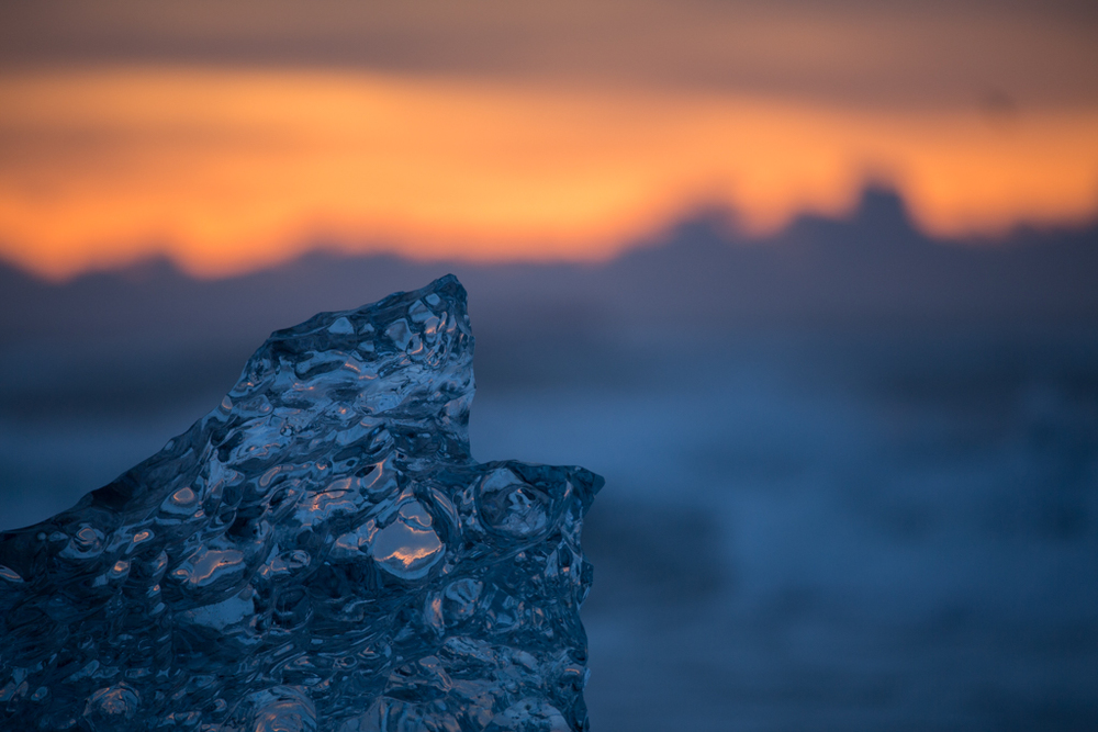 Crystal ice with silhouette of mountains