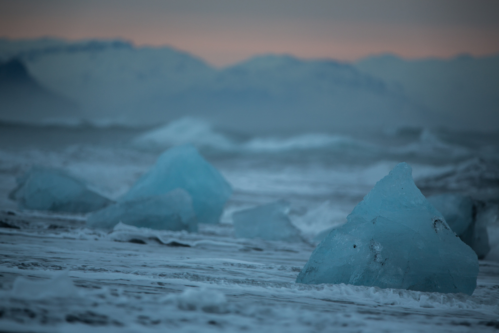 Blue iceblocks on the beach